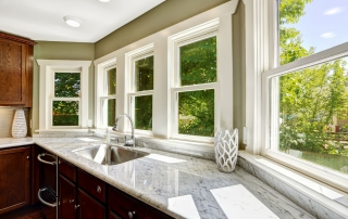 beautiful kitchen cabinet with marble top and steel sink