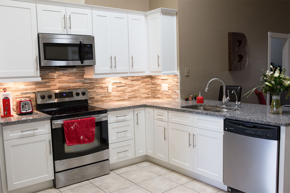 kitchen with white cabinets and gray granite countertops