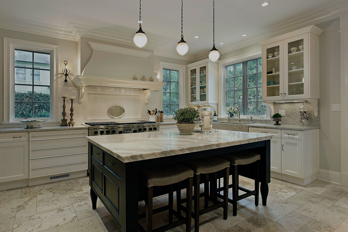 luxury kitchen with large island with white and black granite countertops