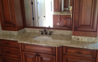 granite bathroom vanity with a single sink