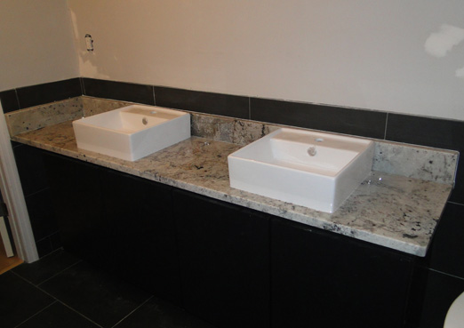 dual porcelain sinks with white granite vanity top