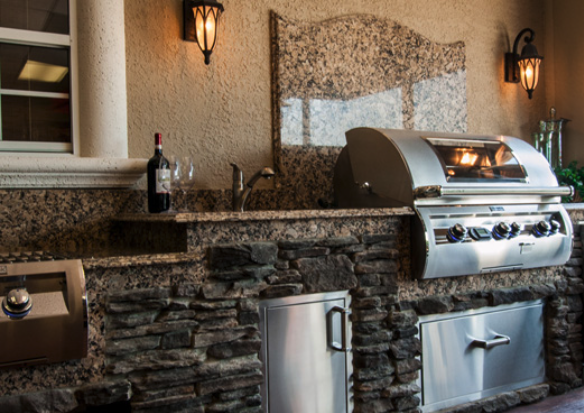 custom granite countertops and wall for gourmet outdoor kitchen