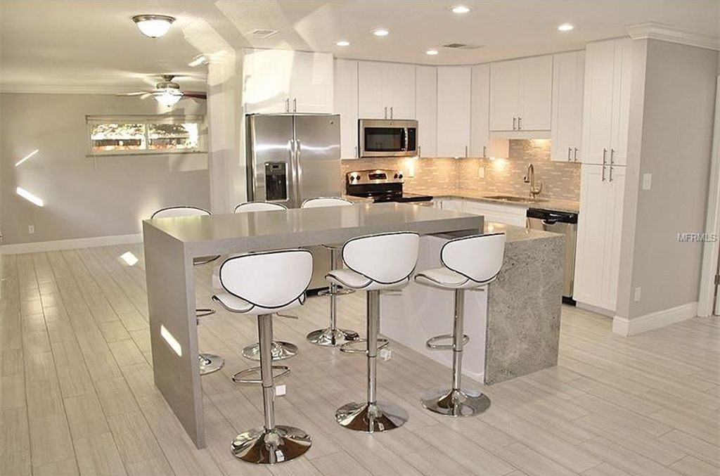 modern white kitchen with light custom granite countertops