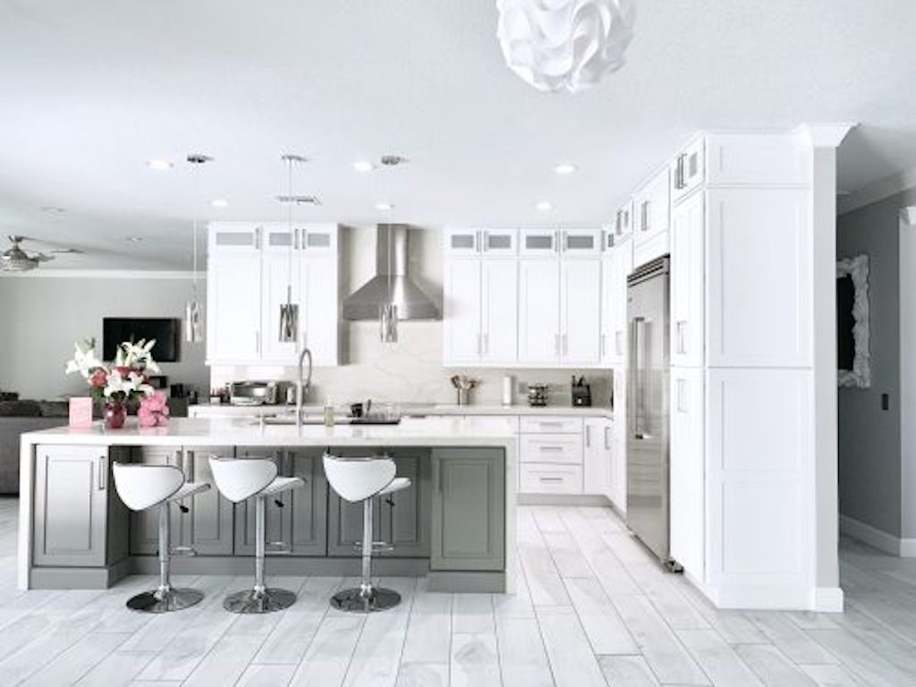 white kitchen granite countertops with custom cabinets