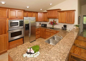 Kitchen with granite kitchen counters