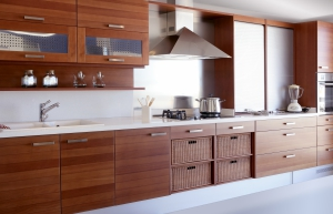 a kitchen with brown cabinets and a white countertop